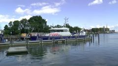 Police Boat on a quay in the harbour of Enkhuizen - stock footage