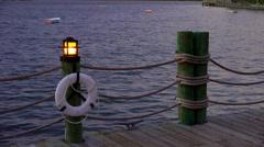 Lantern, life preserver on lake boardwalk Stock Footage