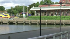 Pan from Railway station to ferry  in the harbour of Enkhuizen Stock Footage