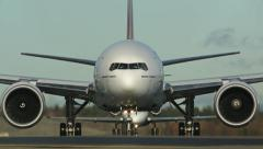 Emirates Boeing 777 taxiing front view Stock Footage