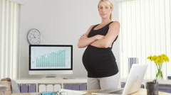 Pregnant businesswoman standing and looking at camera Stock Footage