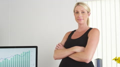 Pregnant businesswoman smiling in the office Stock Footage