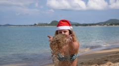 Uplifting Motivational Celebration of Girl on Beach in Santa Hat. Slow Motion. Stock Footage
