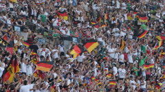 German Happy Crowd People Waving Flag Celebrating Cheering Germany Football Team - stock footage