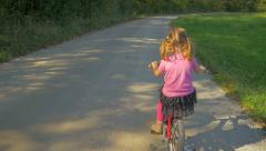 HD Slow-Mo: Little Girl on Bike Overpass From Right Side Stock Footage