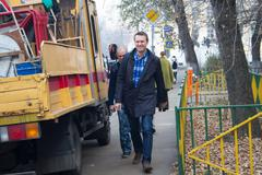 Politician alexei navalny accompanied by an employee of the federal penitenti Stock Photos