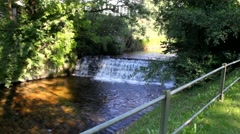 River Oos with waterfall In Baden-Baden. Germany Stock Footage