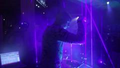 Man using lasers as musical instrument in concert 4 Stock Footage
