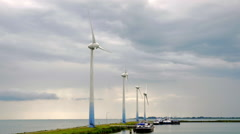 Scenery with wind turbines rotating Stock Footage