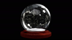 Snow globe on black background with alpha channel Stock Footage