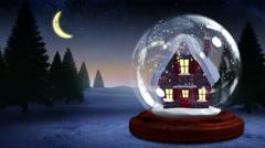 Cute christmas house inside snow globe - stock footage