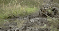 4x4 offroad vehicle driving throug the mud  fs700 4k Stock Footage