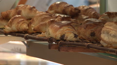 CU Croissants and Pain au Chocolate on a shelf Stock Footage