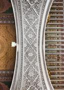 the marble craft and wooden painting of arch at bahia palace in marrakesh - stock photo