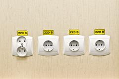 Plug socket 220 volt on the wall - stock photo