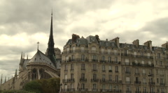 Notre Dame Cathedral against a dramatic sky - stock footage
