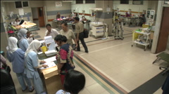 Time-lapse patients and nurses in busy Jakarta hospital ward - stock footage
