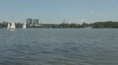 Spectacular landscape, quiet peaceful view in park, small sailing boats floating Stock Footage