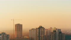 4K Time lapse construction cranes working at sunset in the fog Stock Footage