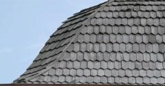black cedar wooden shingle roofs of a house fs700 4k - stock footage