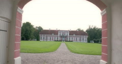 The old manor house inside a big field fs700 4k Stock Footage