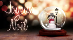 Snowman inside snow globe with magic greeting in french Stock Footage
