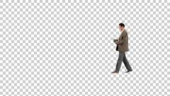 Male with book walking on transparent background Stock Footage