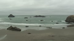 Stock Video Footage of Ocean Three Arch Rocks National Wildlife Refuge Fall Coast Beach Sand Rock