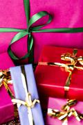 emerald bowknot over magenta gift box . - stock photo