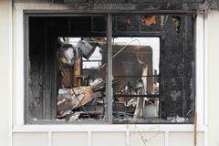 Window of a House Destroyed by Fire Stock Photos