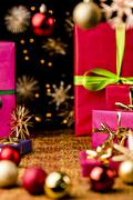 Xmas background with gifts, stars and spheres. Stock Photos
