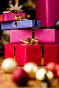 Stack of four presents and spheres. Stock Photos