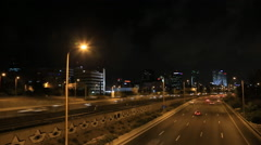 Traffic at night, the city of Tel Aviv, lightnings sparkle Stock Footage