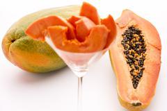 Full of nutrients and papain - the papaya. Stock Photos