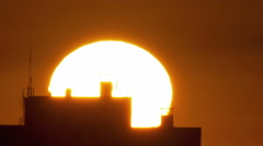 Huge sun,clouds above city buildings.REAL TIME capture! Red Cinema Camera output Stock Footage