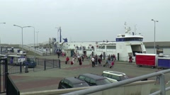 Passengers are leaving the ferry after entrance the harbour Stock Footage