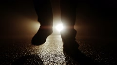 Silhouette of feet walking into dark night. spooky mystical background. Stock Footage