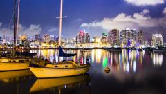 Time Lapse - San Diego Night Time Skyline with boats at waterfront Arkistovideo