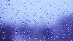 Rainy days on the window glass, weather report ,wallpaper  background Stock Footage