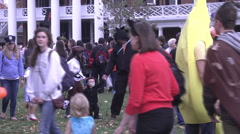 Halloween families and costumes walking by exterior afternoon Stock Footage