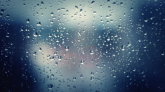 stormy Rainy days on the window glass, weather report ,wallpaper  background - stock footage