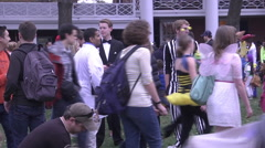 Halloween families and costumes pan left exterior afternoon Stock Footage
