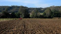 4. Sowing. Seeder for sowing in field. Sower with tractor preparing land. Wide. Stock Footage