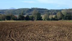 1. Sowing. Agriculture. Seeder in a field. Tractor preparing land for planting. Stock Footage