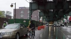 Bicycle Man Pedaling Raining Brooklyn New York City Slow Motion NYC 4K Stock Footage