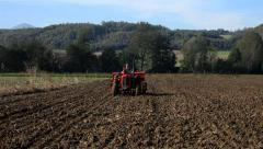 7. Sowing. Seeder in field. Tractor preparing land for planting. Telephoto lens. Stock Footage