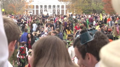Halloween families and costumes telephoto large crowd exterior afternoon Stock Footage
