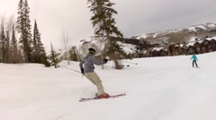 skier doing moguls at ski resort slow motion - stock footage