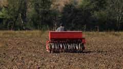 10. Sowing. Seeder for sowing in a field. Tractor preparing land for planting. Stock Footage