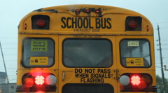 View of schoolbus through windshield. Rain falling. Slightly slo-mo. Stock Footage